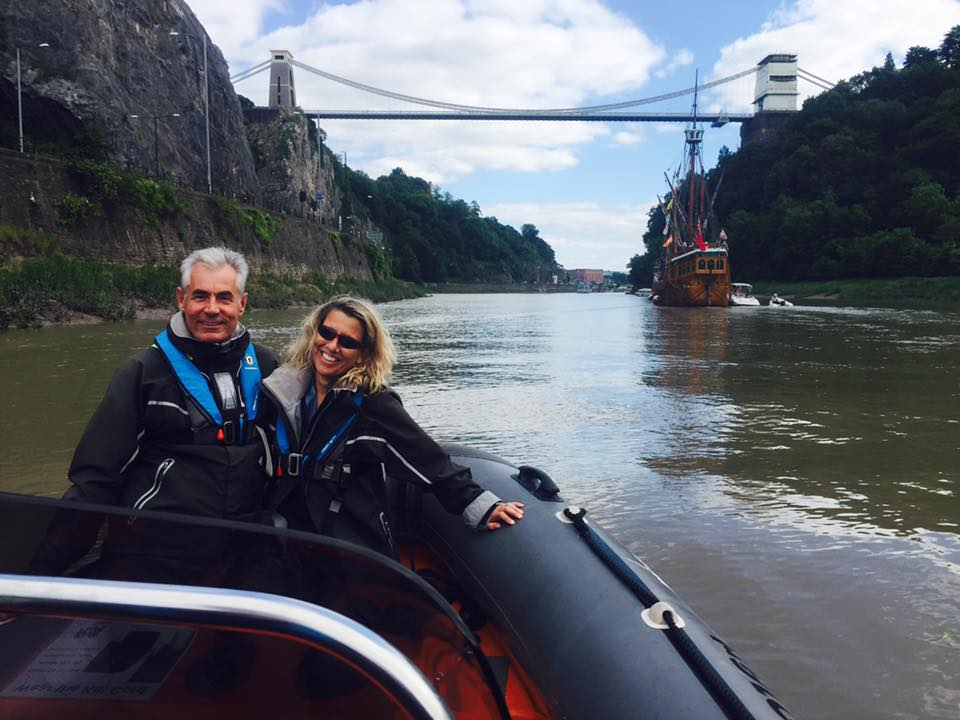 Here's a couple looking really happy on their corporate entertainment package under the clifton suspension bridge as the matthew ship sails by.
