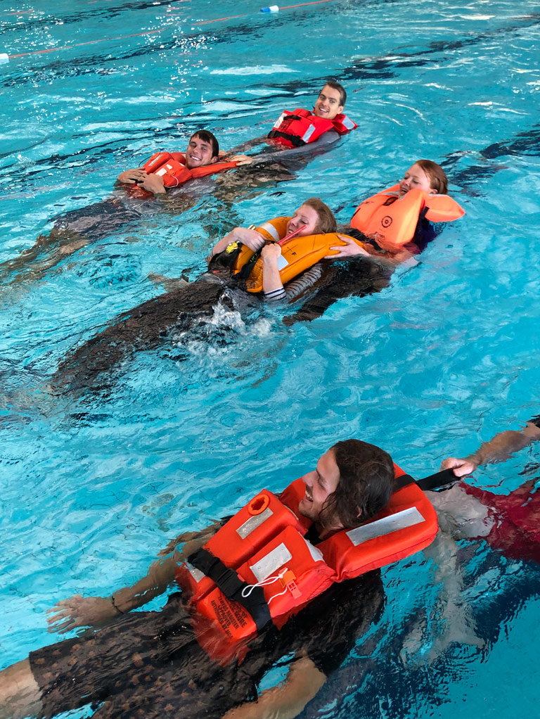 Employees undergoing water safety training at Bristol Maritime Commercial